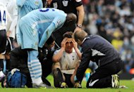 Mario Balotelli (left) stands over Scott Parker following their clash