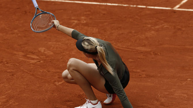 Russia's Maria Sharapova slips on the clay as she plays Czech Republic's Klara Zakopalova during their fourth round match in the French Open tennis tournament at the Roland Garros stadium in Paris, Monday, June 4, 2012.  (AP Photo/Bernat Armangue)