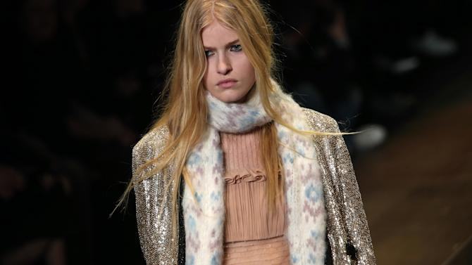 A model presents a creation for Saint Laurent's Fall/Winter 2013-2014 ready to wear collection, in Paris, Monday, March, 4, 2013. (AP Photo/Thibault Camus)