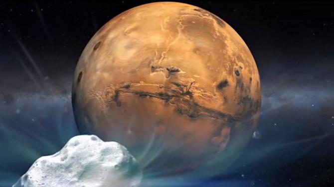 An artist's impression of Comet Siding Spring and Mars, which will come within 87,000 miles of each other on October 19