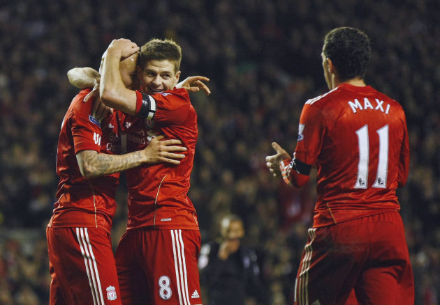 Liverpool's Jonjo Shelvey, left, celebrates with captain Steven Gerrard, center, after he scored a goal against Oldham Athletic during their FA Cup third round soccer match at Anfield, Liverpool, Engl