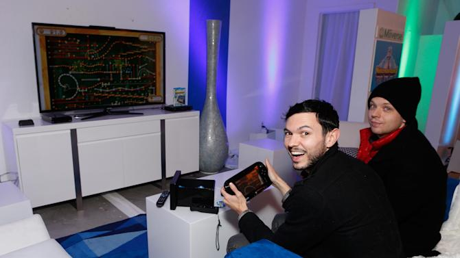 IMAGE DISTRIBUTED FOR NINTENDO OF AMERICA - Bill W., left, and Rich W. from Los Angeles enjoy Nintendo Land on Wii U while attending the Nintendo Lounge during the Sundance Film Festival in Park City, Utah on Jan. 21, 2013. Wii U, a new home console that comes packaged with the Wii U GamePad, a controller with a 6.2-inch touch screen that redefines how people interact with their games, their TVs and one another.  (Photo by Todd Williamson/Invision for Nintendo of America/AP Images)