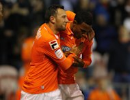 Blackpool's Matt Phillips, right, celebrates with team-mate Neal Eardley after scoring his side's second goal against Leeds