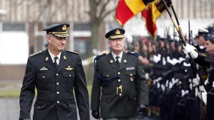 Belgium's King Philippe reviews troops during a visit to the military staff at the Belgian army headquarters in Brussels