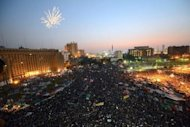 Fireworks light up the sky as Egyptians celebrate in Cairo&#39;s Tahrir Square. Egypt&#39;s Mohamed Morsi, the first Islamist to be elected president of the Arab world&#39;s most populous nation, said Sunday he will be a leader &quot;for all Egyptians&quot; and called for national unity after a polarising race