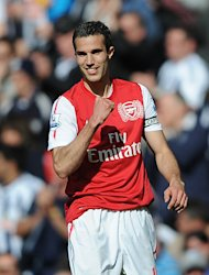Nigel Winterburn hopes Arsenal splash the cash in order to keep Robin Van Persie (pictured)