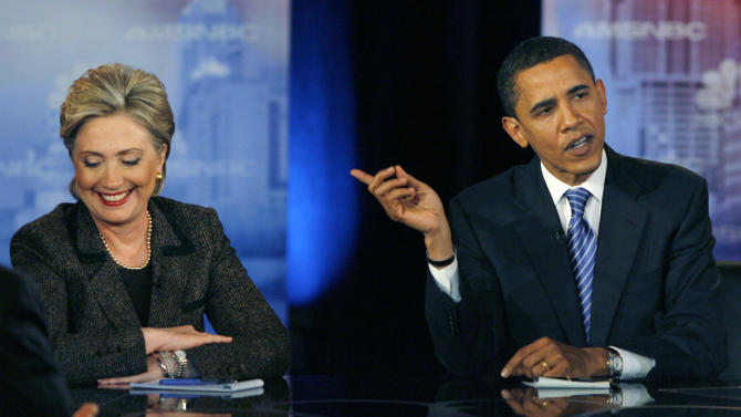 US Democratic presidential candidates Senator Barack Obama makes a point as Senator Hillary Clinton reacts in the last debate before the Ohio primary in Cleveland