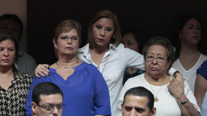 Relatives of former Salvadoran army officers participate in a press conference in San Salvador