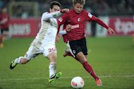 Leverkusen's defender Daniel Carvajal (R) clashes with Freiburg's defender Vegar Hedenstad during their German first division Bundesliga football match in Freiburg, southern Germany, on January 26, 2013. Bayer Leverkusen reclaimed second place in the Bundesliga from defending champions Borussia Dortmund on Saturday, despite being held to a goalless draw at gritty Freiburg
