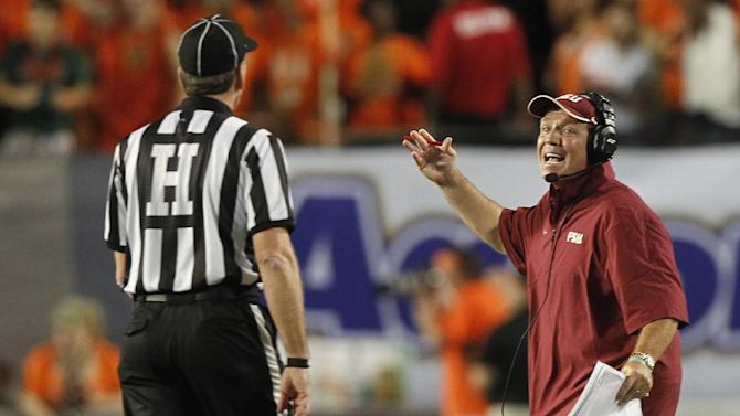 Florida State head coach Jimbo Fisher, right, talks with a referee during the first half of an NCAA college football game against Miami, Saturday, Oct. 20, 2012, in Miami. (AP Photo/Alan Diaz)