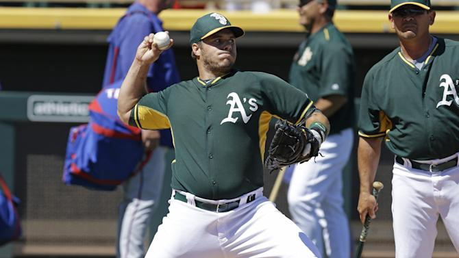 Oakland Athletics catcher Josh Phegley throws during batting practice prior to a spring training exhibition baseball game against the Texas Rangers Friday, March 27, 2015, in Mesa, Ariz. (AP Photo/Ben Margot)