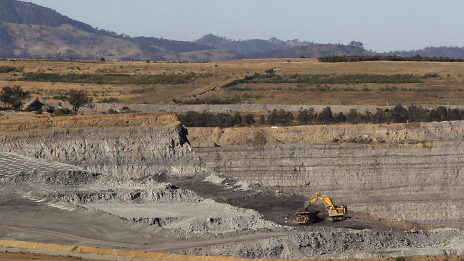 """This Sept. 11, 2012 photo shows a coal mine near Gunnedah, Australia, 450 kilometers (280 miles) northwest of Sydney. Gunnedah, whose previous heyday came during the 1950s wool boom, may be undergoing one of its biggest transformations since it was settled in 1856, says former Mayor Adam Marshall. """"We did have a mini coal boom in the early 1980s, but nothing on the scale which we're seeing now."""" (AP Photo/Rob Griffith)"""