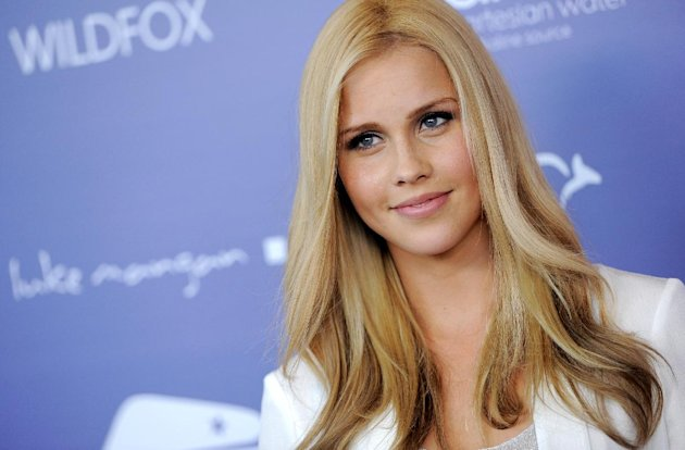 "FILE - This June 27, 2012 photo shows actress Claire Holt poses at the Australians in Film 8th Annual Breakthrough Awards in Los Angeles. Holt is a cast member on ""The Vampire Diaries,"" which premieres its fourth season on The CW Thursday, Oct. 11. (Photo by Chris Pizzello/Invision/AP, file)"