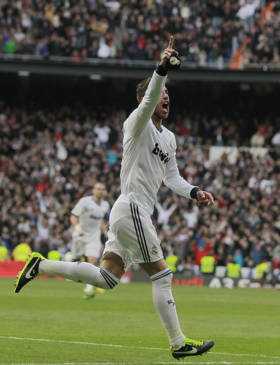 Real Madrid's Sergio Ramos celebrates his goal during a Spanish La Liga soccer match against FC Barcelona at the Santiago Bernabeu stadium in Madrid, Spain, Saturday, March 2, 2013. (AP Photo/Andres K