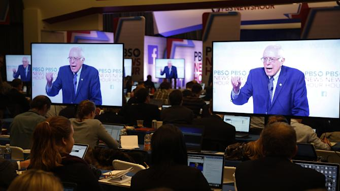 Journalists work in the media filing room as Democratic presidential candidate, Sen. Bernie Sanders, I-Vt, speak during a Democratic presidential primary debate at the University of Wisconsin-Milwaukee, Thursday, Feb. 11, 2016, in Milwaukee. (AP Photo/Tom Lynn)
