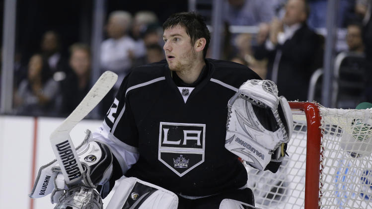 Los Angeles Kings goalie Jonathan Quick stands near the net toward the close of the third period in Game 1 of their second-round NHL hockey Stanley Cup playoff series against the San Jose Sharks in Los Angeles, Tuesday, May 14, 2013. (AP Photo/Chris Carlson)