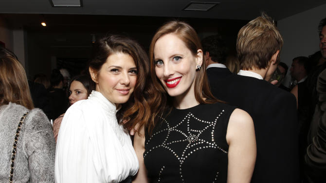 Marisa Tomei and Liz Goldwyn salute legend of art and fashion Mario Testino with cocktails by Porton at the Peruvian native's exhibition at Prism on Saturday February 23, 2013 in Los Angeles. (Photo by Todd Williamson/Invision for Porton/AP)
