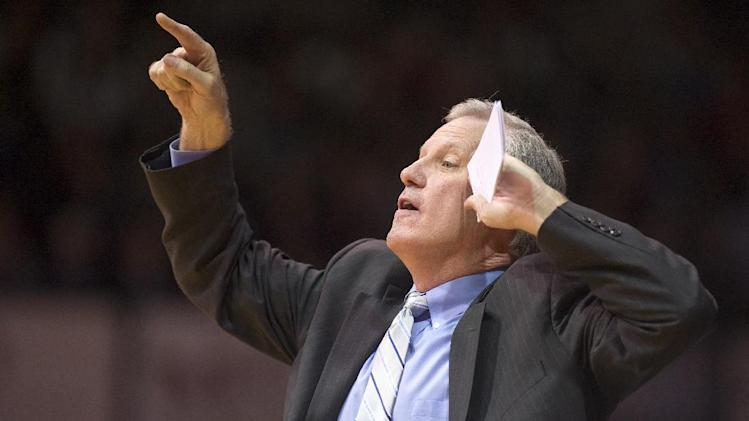 Saint Louis Billikens' head coach, Jim Crews, directs the players on the floor during the first half of an NCAA college basketball game  Friday, Feb. 22, 2013, in Indianapolis. (AP Photo/Doug McSchooler)
