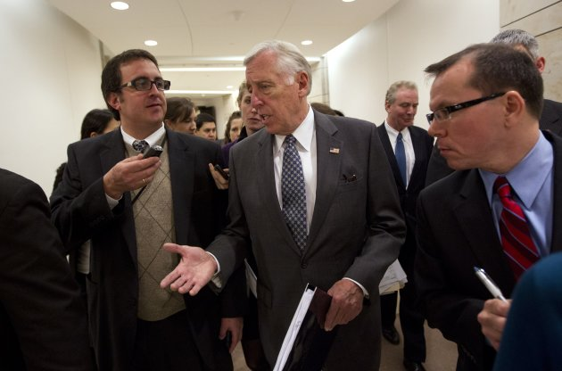 House Minority Whip Rep. Steny Hoyer, D-Md., is followed by reporters after holding a news conference on the payroll tax cut on Capitol Hill on Thursday, Dec. 22, 2011 in Washington. (AP Photo/Evan Vucci)