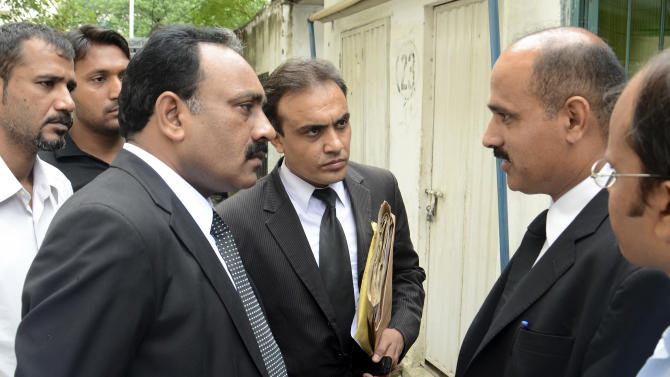 Tahir Naveed Chaudhry, left, the lawyer of a Christian girl accused of blasphemy, talks with other lawyers outside a court proceeding in Islamabad, Pakistan on Friday, Sept. 7, 2012. A Pakistani judge granted bail Friday to a young, mentally challenged Christian girl accused of insulting Islam for burning pages of the religion's holy book. Rights activists welcomed the decision after calling for her release since she was arrested three weeks ago. (AP Photo/B.K. Bangash)