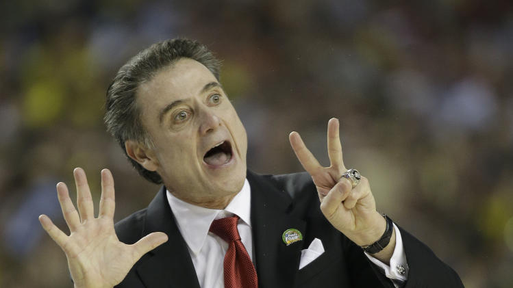 Louisville head coach Rick Pitino reacts to play against the Michigan during the first half of the NCAA Final Four tournament college basketball championship game Monday, April 8, 2013, in Atlanta. (AP Photo/David J. Phillip)