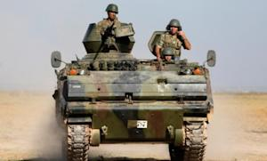 Turkish soldiers patrol the Turkey-Syrian border on Oct. 4: Turkey has gone on the defensive after a Syrian mortar attack killed five Turkish civilians.