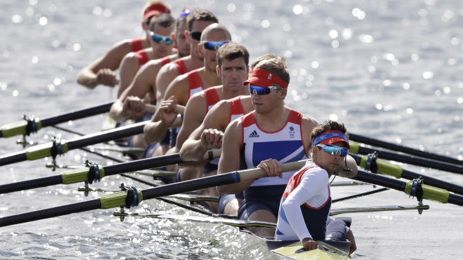 Great Britain's, from right, Phelan Hill, Constantine Louloudis, Matthew Langridge, Greg Searle, Mohamed Sbihi, Richard Egington, Tom Ransley, James Ford, and Alex Partridge wait for the start of a men's rowing eight repechage in Eton Dorney, near Windsor, England, at the 2012 Summer Olympics, Monday, July 30, 2012. (AP Photo/Chris Carlson)