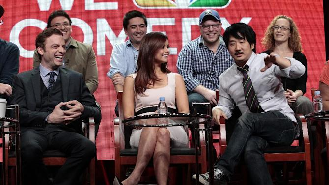 """This Tuesday, July 24, 2012 photo released by NBC shows, front row from left, Justin Kirk, JoAnna Garcia Swisher and Bobby Lee with showrunners for the upcoming comedy """"Animal Practice"""" during the NBCUniversal Press Tour in Beverly Hills, Calif. The series premieres Wednesday, Sept. 26, at 8 p.m. EST on NBC. (AP Photo/NBC, Chris Haston)"""