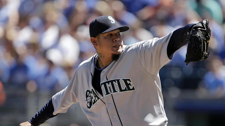Seattle Mariners starting pitcher Felix Hernandez throws during the first inning of a baseball game against the Kansas City Royals, Monday, Sept. 2, 2013, in Kansas City, Mo. (AP Photo/Charlie Riedel)