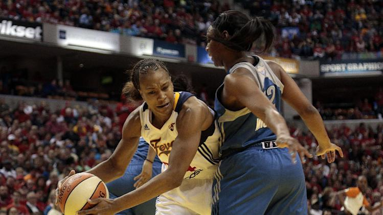Indiana Fever forward Tamika Catchings, left, looks to pass around Minnesota Lynx guard Monica Wright in the second half of Game 3 of the WNBA basketball Finals, Friday, Oct. 19, 2012, in Indianapolis. The Fever won 76-59. (AP Photo/AJ Mast)