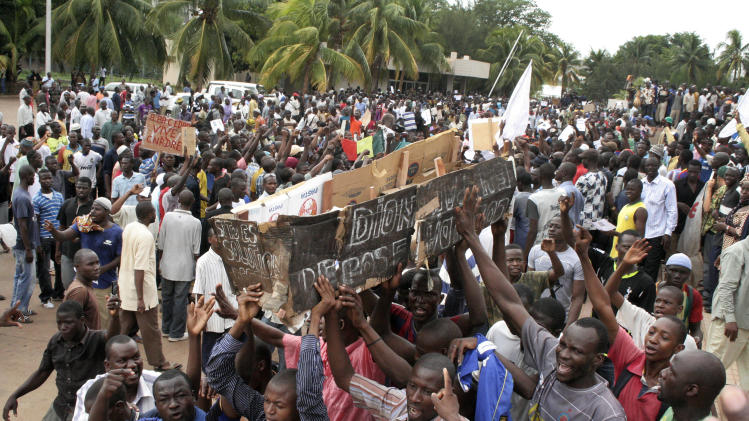 Protesters carry a coffin marked with the name of  interim president Dioncounda Traore in Bamako, Mali, Monday May 21, 2012. They were protesting Traore's nomination to  transitional president for the next 12 months. The junta led by Capt. Amadou Sanogo had been opposed to the extension of the interim president's term, which under the Malian constitution was due to run out on Tuesday. ECOWAS had threatened to reimpose sanctions on Mali if the junta did not stop interfering in the transition. (AP Photo/Harouna Traore)