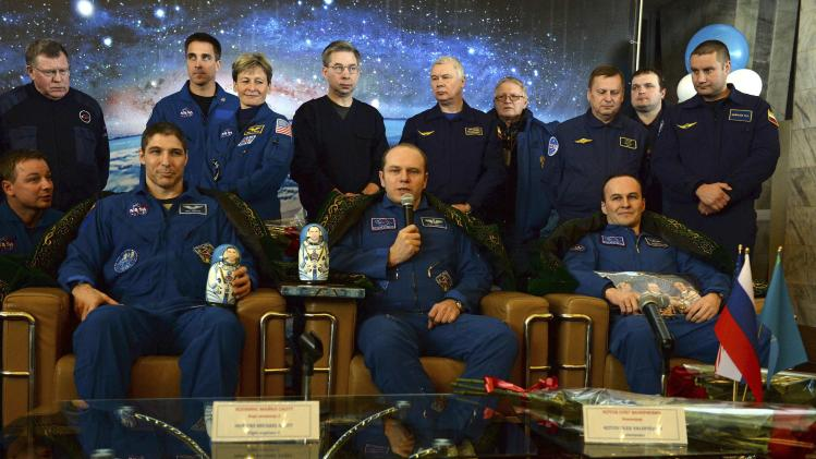 Former ISS commander Kotov and flight engineers Ryazansky of Russia and Hopkins from the U.S. attend a news conference in Karaganda