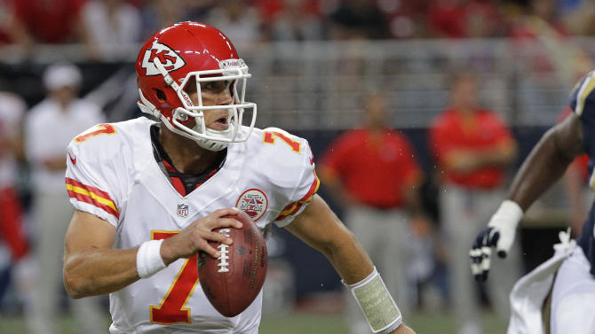 FILE - This Aug. 18, 2012 file photo shows Kansas City Chiefs quarterback Matt Cassel running with the ball during the first quarter of a preseason NFL football game against the St. Louis Rams, in St. Louis. All anybody wants to talk about in Kansas City is whether Dwayne Bowe will be ready for Friday night's game against Seattle. But the guy throwing him the ball has been in the spotlight all off-season, and that hasn't stopped during training camp. (AP Photo/Seth Perlman, File)
