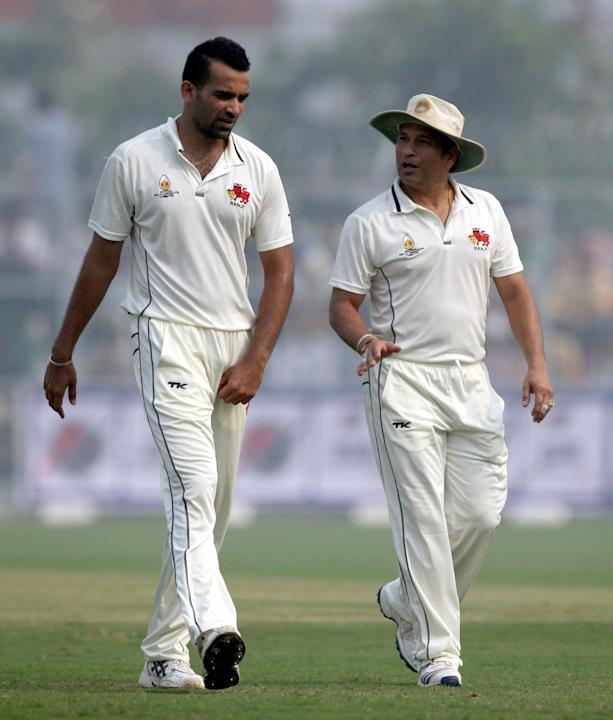 Sachin Tendulkar with Mumbai captain Zaheer Khan during master blaster's last Ranji match for Mumbai against Haryana in Lahli, Rohtak on Oct.27, 2013. (Photo: IANS)