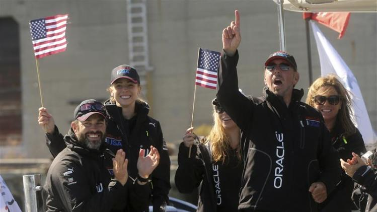 Oracle CEO Ellison reacts after Oracle Team USA defeated Emirates Team New Zealand during Race 18 of the 34th America's Cup yacht sailing race in San Francisco