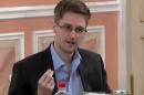 In this image made from video released by WikiLeaks on Friday, Oct. 11, 2013, former National Security Agency systems analyst Edward Snowden speaks during a presentation ceremony for the Sam Adams Award in Moscow, Russia. Should Snowden ever return to the U.S., he would face criminal charges for leaking information about NSA surveillance programs. But legal experts say a trial could expose more classified information as his lawyers try to build a case in an open court that the operations he exposed were illegal. (AP Photo)
