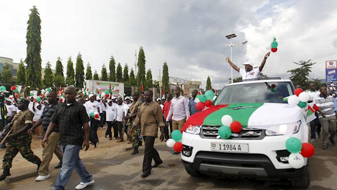 Burundi's President Nkurunziza waves to supporters of the ruling CNDD-FDD party after their congress meeting in the capital Bujumbura