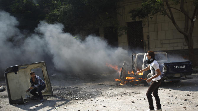 Egyptian protesters throw stones during clashes near the U.S. embassy in Cairo, Egypt, Thursday, Sept. 13, 2012. Protesters clashed with police near the U.S. Embassy in Cairo for the third day in a row. Egypt's Islamist President Mohammed Morsi vowed to protect foreign embassies in Cairo, where police were using tear gas to disperse protesters at the U.S. mission. (AP Photo/Khalil Hamra)