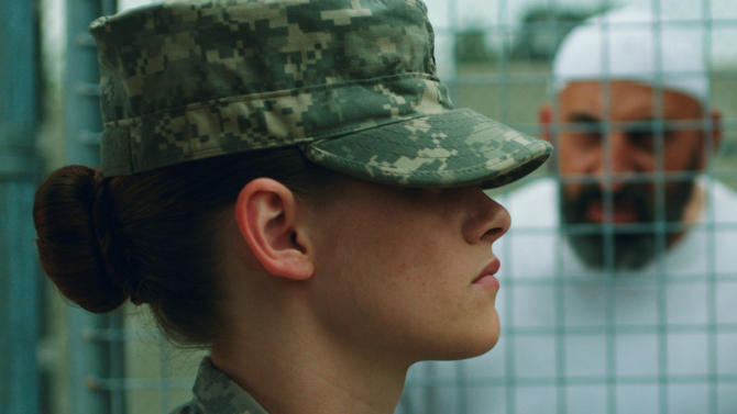 """This photo provided by the Sundance Institute shows Kristen Stewart in a scene from the film, """"Camp X-Ray."""" In her first feature since """"The Twilight Saga: Breaking Dawn - Part 2,"""" Stewart plays a guard stationed in Guantanamo Bay in budding writer/director Peter Sattler's film. Ladies continue to drive the lineup of the Sundance Film Festival as Robert Redford's independent-cinema fair will celebrate its 30th anniversary starting Jan. 16, 2014, in Park City, Utah. (AP Photo/Sundance Institute, Beth Dubber)"""