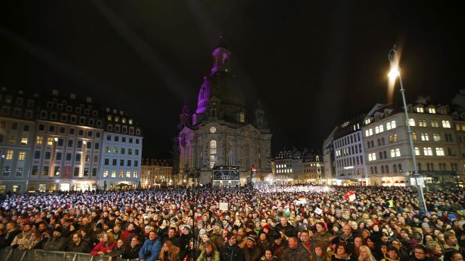 People attend a rally to protest against the movement of Patriotic Europeans Against the Islamisation of the West (PEGIDA) in front of the Frauenkirche church in Dresden