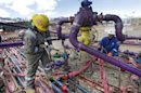 FILE - In this March 29, 2013 file photo, workers tend to a well head during a hydraulic fracturing operation at an Encana Oil &amp; Gas (USA) Inc. gas well outside Rifle, in western Colorado. The Obama administration is proposing a rule that would require companies that drill for oil and natural gas on federal lands to publicly disclose chemicals used in hydraulic fracturing operations. The new &quot;fracking&quot; rule replaces a draft proposed last year that was withdrawn amid industry complaints that federal regulation could hinder an ongoing boom in natural gas production. (AP Photo/Brennan Linsley, File)