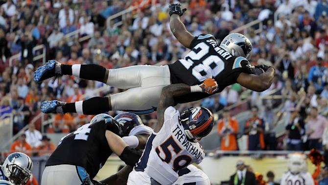 Defenses dominate, Broncos lead Panthers 13-7.