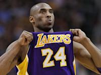 Los Angeles Lakers' Kobe Bryant adjusts his jersey during the first half of an NBA basketball game against the Phoenix Suns, Sunday, Feb. 19, 2012, in Phoenix. (AP Photo/Matt York)