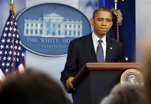 U.S. President Barack Obama pauses while talking in the White House Press Briefing Room in Washington