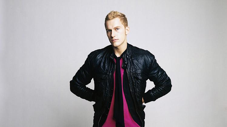 "Jonathan poses during a photo shoot on ""Make Me a Supermodel."""