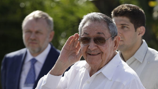 "Cuba's President Raul Castro, center, cups his hand to ear his ear to better hear a reporter's question outside the Internationalist Soviet soldier mausoleum where he attended a tribute with the visiting Prime Minister of Russia, Dmitry Medvedev, in Havana, Cuba, Friday, Feb. 22, 2013. The Cuban leader raised the possibility of leaving his post, during an appearance Friday. Castro told reporters he's about to turn 82 years old and added, ""I have the right to retire, don't you think?"" (AP Photo/Franklin Reyes)"