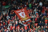 A banner praising the findings of a recent report into the Hillsborough disaster is unfurled in the crowd by Liverpool supporters before the Premier League match between Liverpool and Manchester United at Anfield in Liverpool. Robin van Persie's second-half penalty secured a 2-1 Premier League win for Manchester United over 10-man Liverpool at an emotionally-charged Anfield
