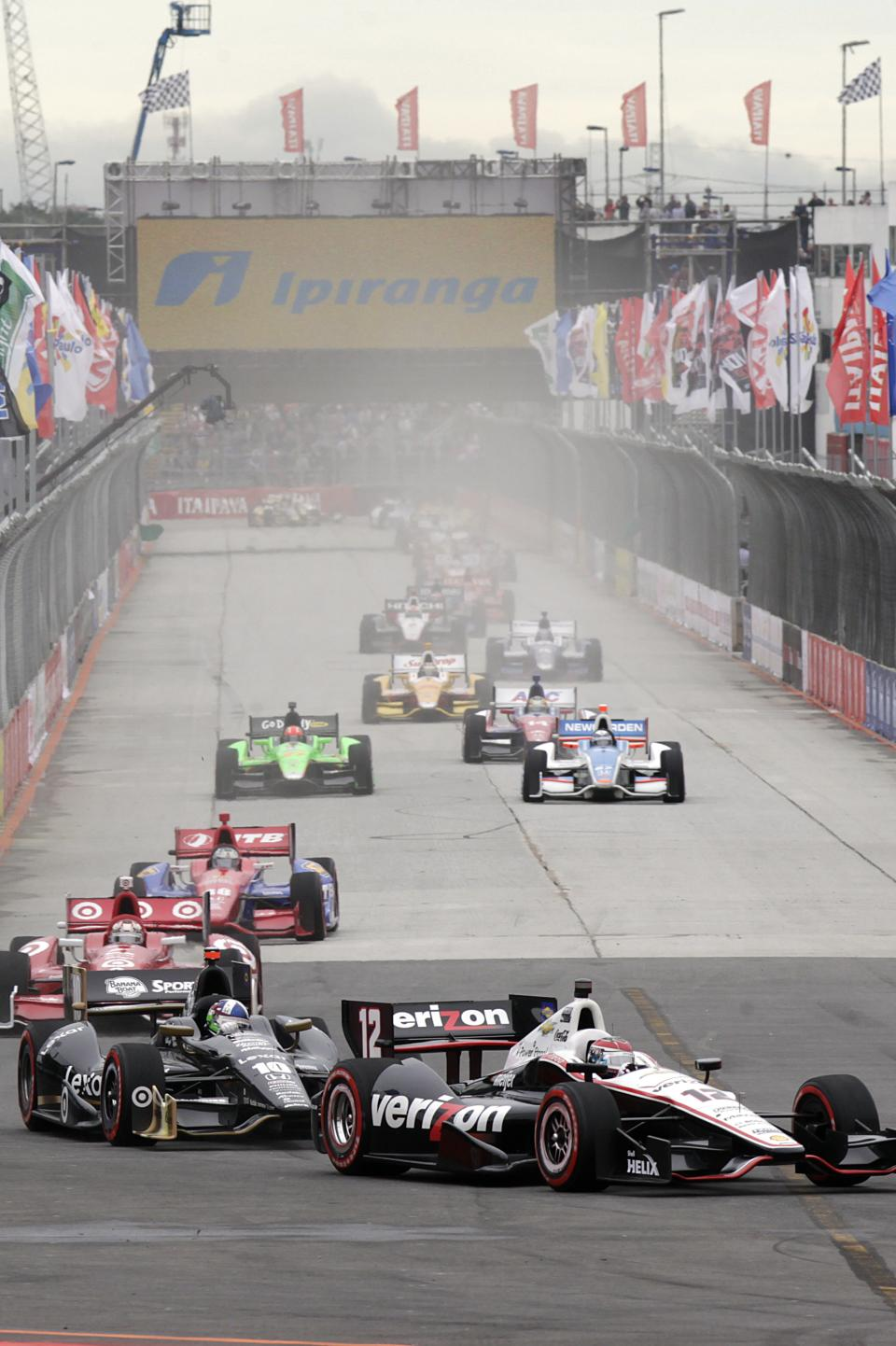 IndyCar driver Will Power, of Australia, leads the pack during the IndyCar Sao Paulo 300, in Sao Paulo, Brazil, Sunday, April 29, 2012. (AP Photo/Andre Penner)