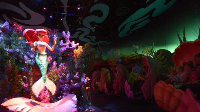 Tourists experience the Under the Sea--Journey of the Little Mermaid ride in clamshells during grand opening of the New Fantasyland attraction at the Walt Disney World Resort's Magic Kingdom theme park in Lake Buena Vista, Fla., Thursday, Dec. 6, 2012. The new attraction is the largest expansion at the Magic Kingdom.(AP Photo/Phelan M. Ebenhack)