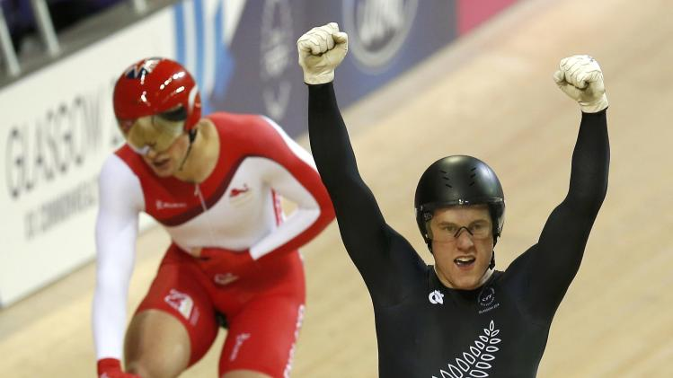 New Zealand's Webster celebrates in front of England's Kenny after winning the men's sprint finals cycling race at the 2014 Commonwealth Games in Glasgow